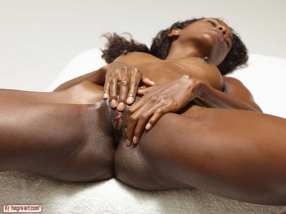 Skinny black babe Valerie totally nude and wet with massage oil ...